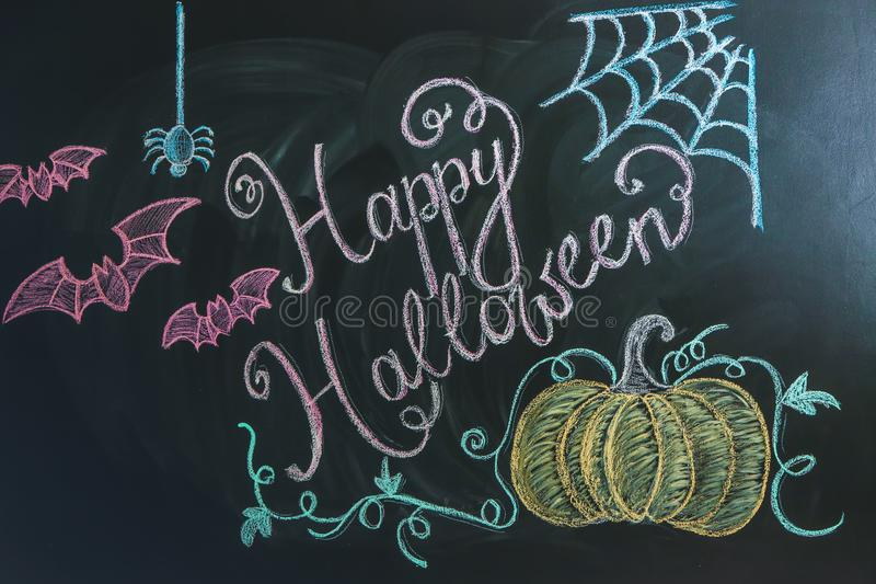 Drawings with text Happy Halloween on dark background royalty free stock photos