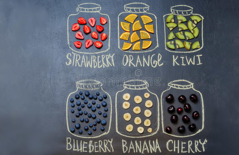 Drawn with chalk jars with fruit and berries royalty free stock photo