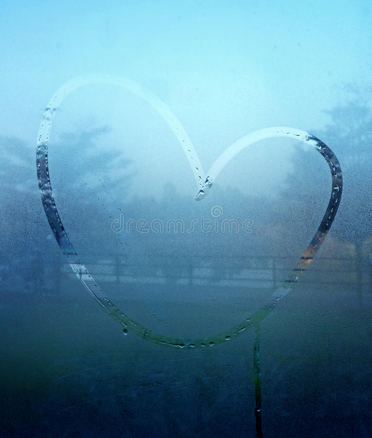 Drawn heart on the wet glass.  royalty free stock photos
