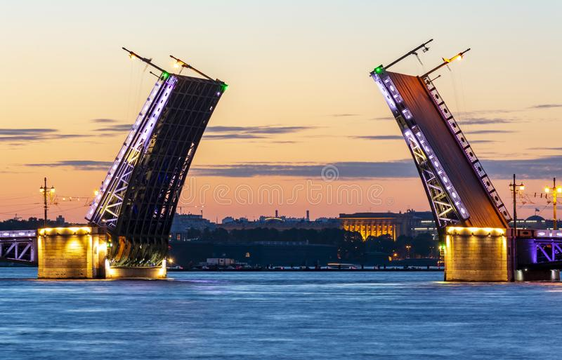 Drawn Palace Bridge and Neva river at summer night, St. Petersburg, Russia stock photography