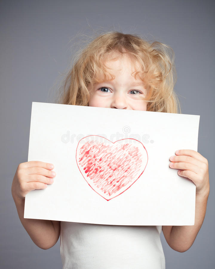 Drawn red heart. Drawn heart in baby hands. Valentine`s day concept royalty free stock photos
