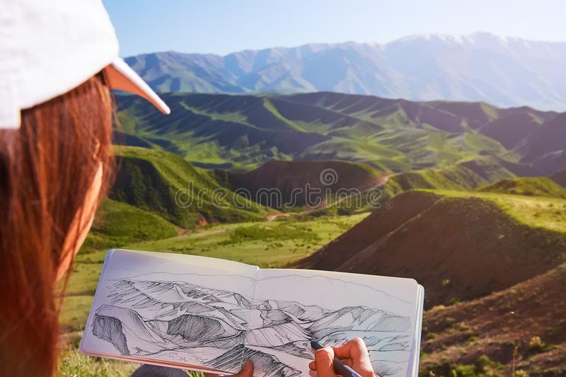 Draws on nature. Painting outdoors. Kazakhstan. Mountain spring landscape stock photography