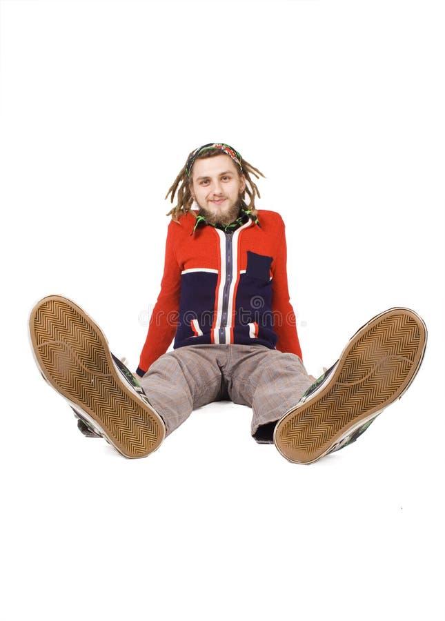 dreadlock查出的人坐年轻人 图库摄影