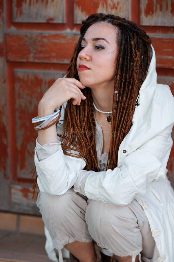 Dreadlocks fashionable girl portrait, dressed in white stock photos