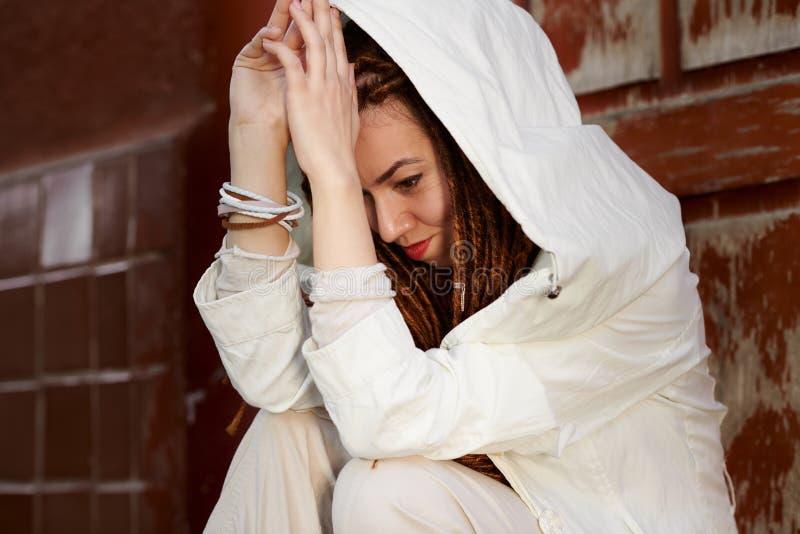 Dreadlocks fashionable girl portrait, dressed in white stock images
