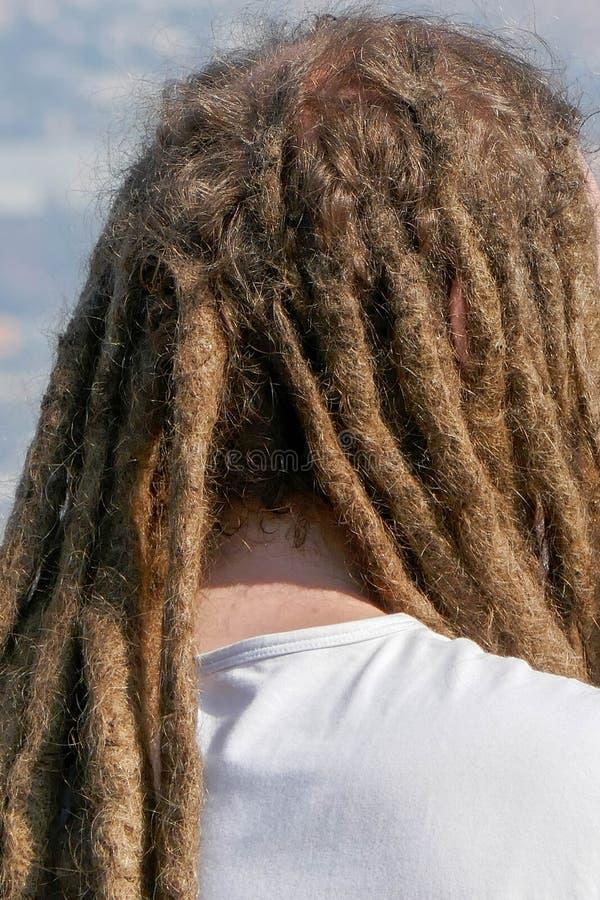 Dreadlockskapsel van de mens De stijl van haar dreadlocks reggae stock foto