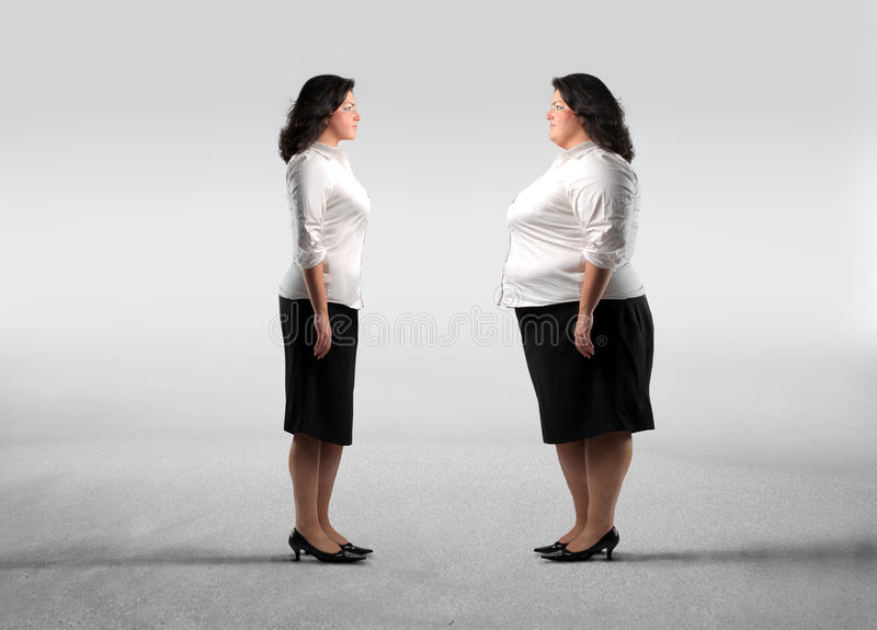 Dream. Fat woman standing in front of her thinner alter ego