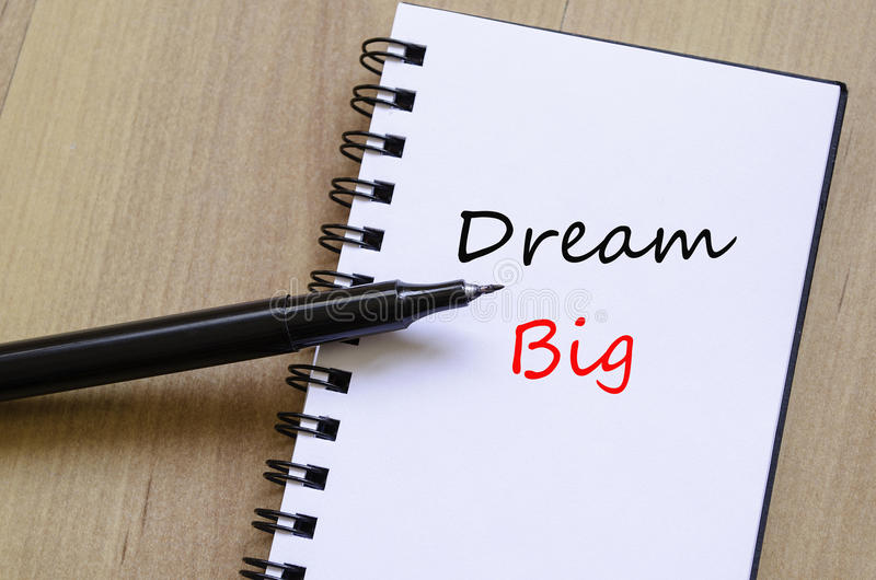 Dream Big Concept over wooden background. Dream big concept notepad over wooden background stock images
