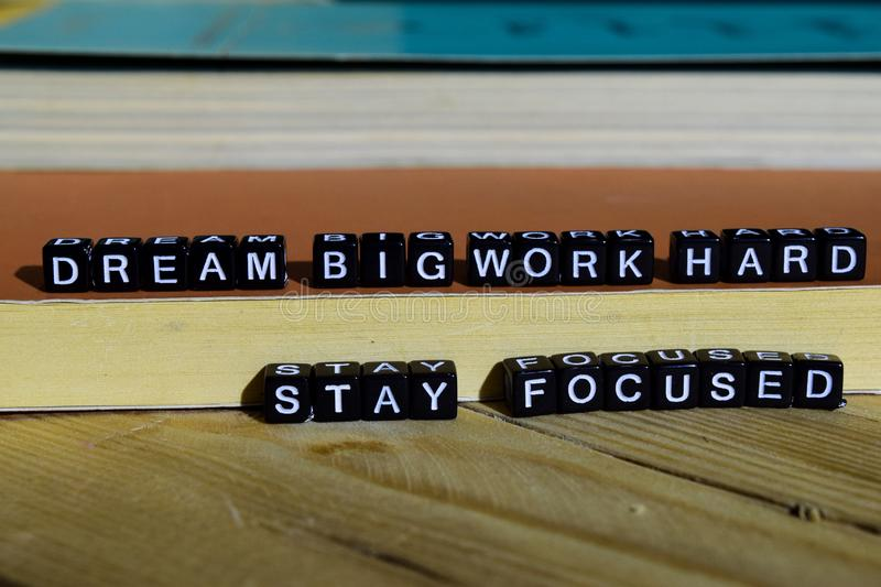 Dream big work hard stay focused on wooden blocks. Motivation and inspiration concept. Cross processed image stock images