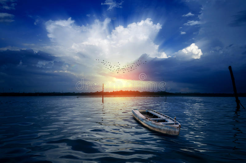 Dream Boat Morning birds flying on dramatic sky at sunrise sunset. Over beautiful ganges river in Banaras India asia royalty free stock image