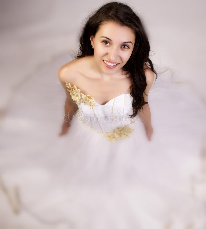 Dream Bride. Bride posing in a dream like white wedding dress stock images