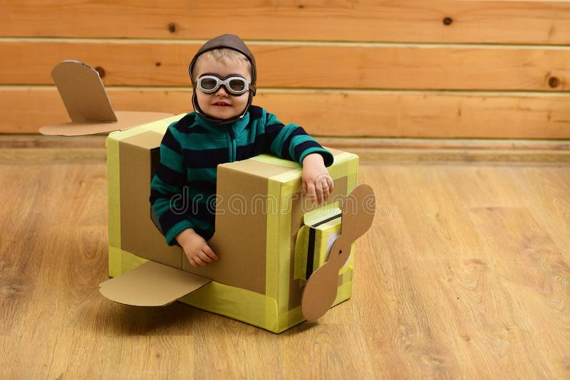 Dream, career, adventure, education. Kid, pilot school, innovation. Pilot travel, airdrome, imagination. Air mail delivery aircraft construction Little boy royalty free stock photos