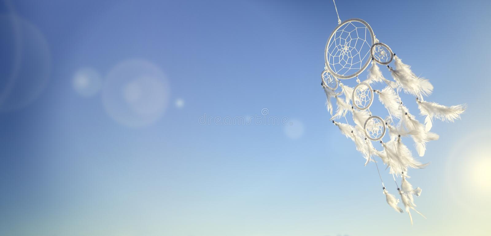 Dream catcher on blue sky background with copy space royalty free stock image