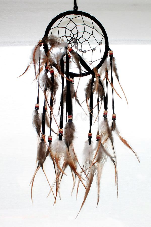 Dream catcher with feathers threads and beads rope hanging. Dreamcatcher handmade. royalty free stock photography
