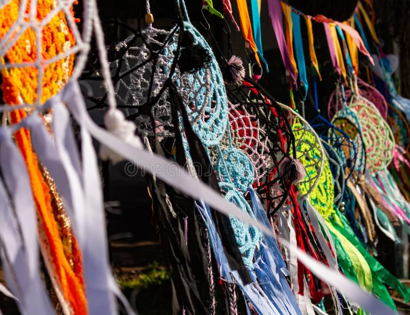 Dream catcher made of handmade colors hanging in the sun and moved by the wind. Typical handicrafts of Native Americans. Decoration made of woven wool stock image