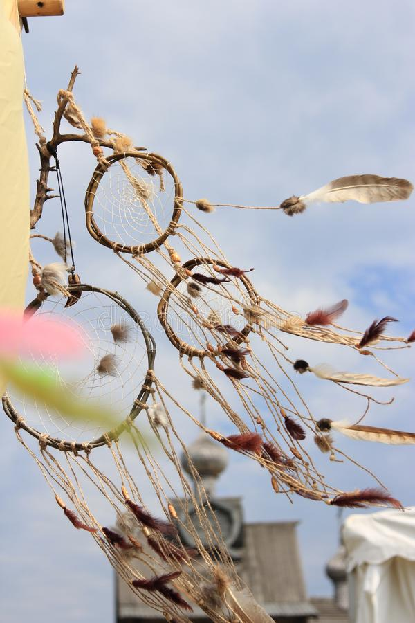 Dream catcher in the wind. Beautiful and light dream catcher floating in the wind. Open-air fair stock photo