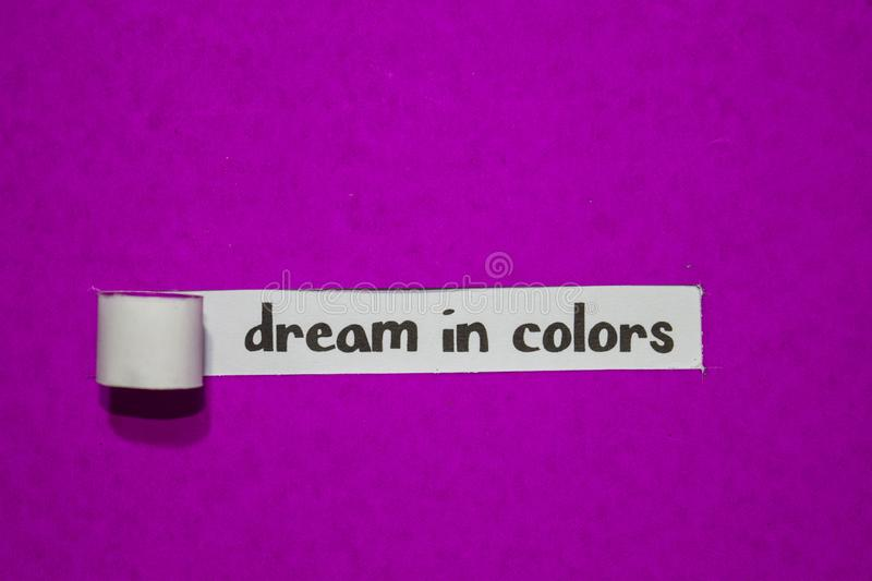 Dream in colors, Inspiration, Motivation and business concept on purple torn paper stock image