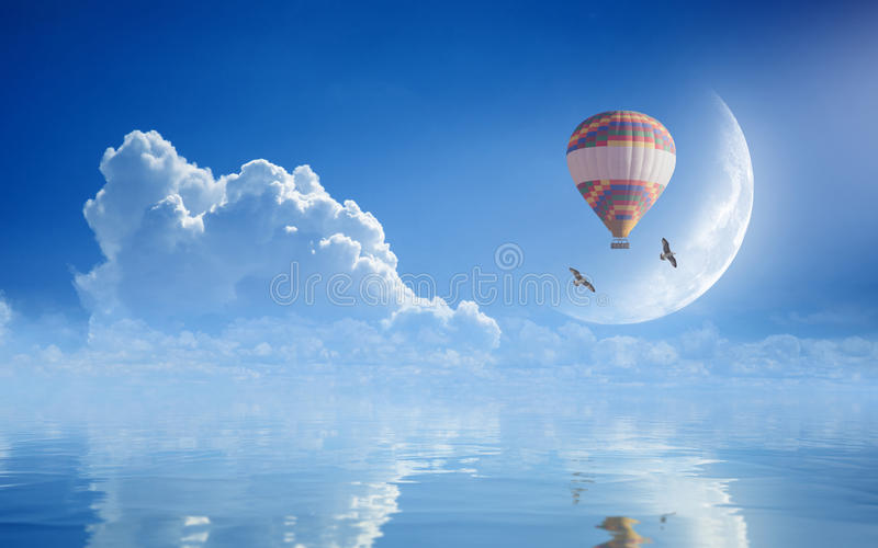 Dream come true concept - hot air balloon in blue sky royalty free stock photography