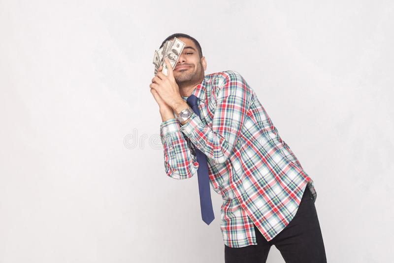 Dream come true! Satisfied rich handsome bearded businessman in stock image