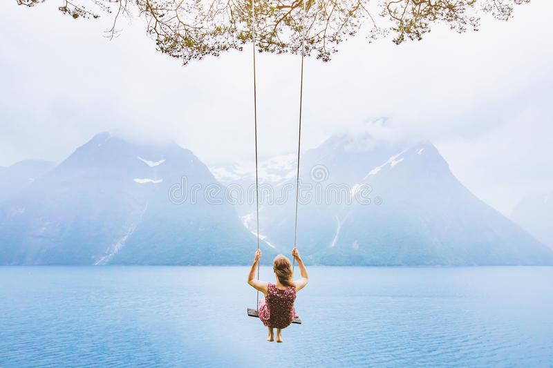 Dream concept, beautiful young woman on the swing royalty free stock photo