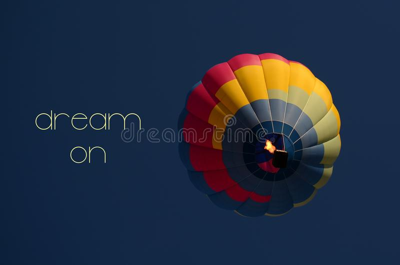 Dream on concept. Hot air balloon colorful in sky. Dream on concept. Hot air balloon colorful in blue sky. Freedom, flying, travel, dream concept stock photo
