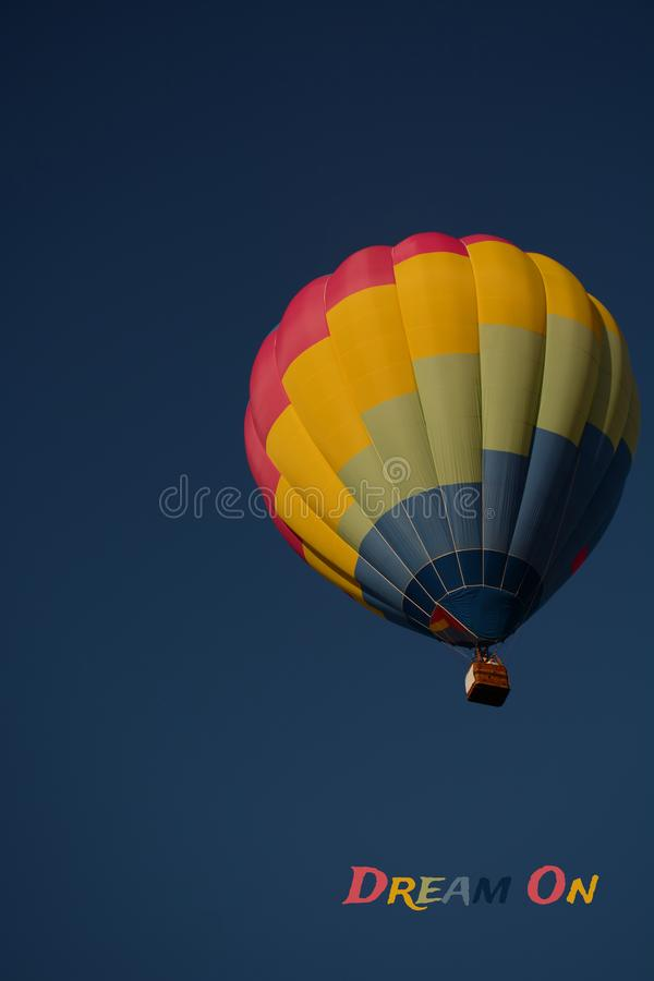 Dream on concept. Hot air balloon colorful in sky. Dream on concept. Hot air balloon colorful in blue sky. Freedom, flying, travel, dream concept royalty free stock image