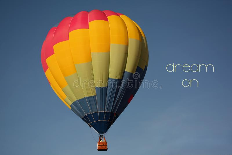 Dream on concept. Hot air balloon colorful in sky. Dream on concept. Hot air balloon colorful in blue sky. Freedom, flying, travel, dream concept stock images