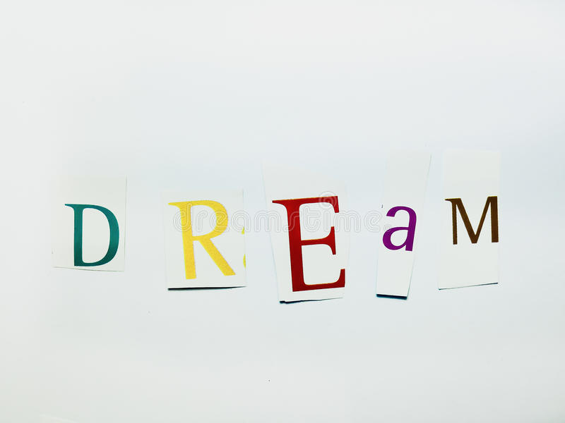 Dream cutout words collage of mixed magazine letters with white download dream cutout words collage of mixed magazine letters with white background stock image publicscrutiny Choice Image