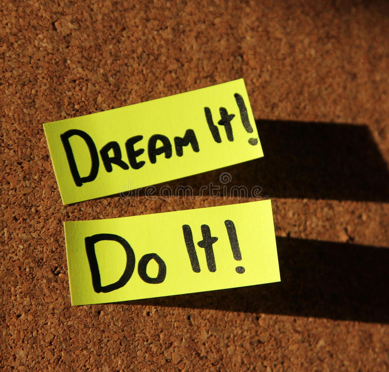 Dream it, do IT!. Sticky notes forming text - dream it, do it royalty free stock photos