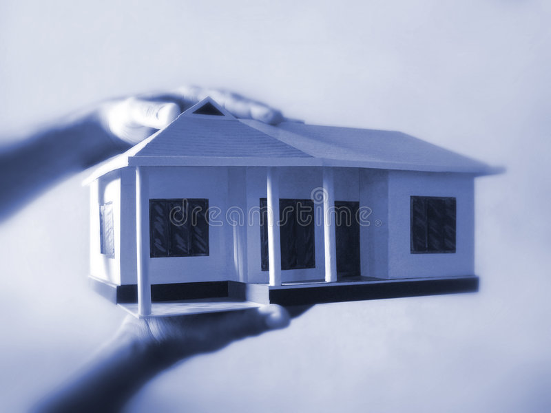 Dream Home. Home model holding in the hands