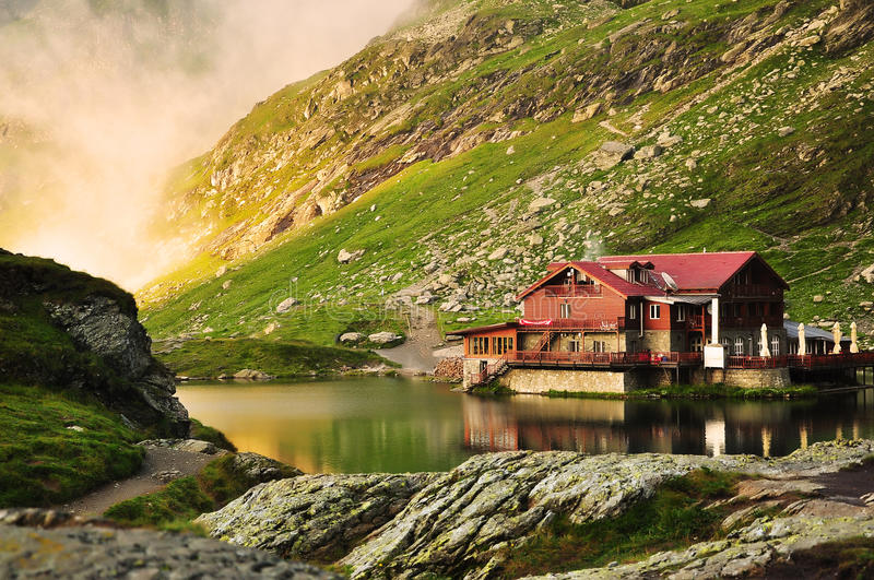 Dream lake house in the mountains. The Bâlea Lake is a glacier lake situated at 2,034 m of altitude in the Făgăraş Mountains, in central Romania, in royalty free stock photos