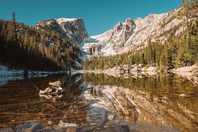 Dream Lake, Rocky Mountains, Colorado, USA. Dream Lake and reflection with mountains in snow around at autumn. Rocky Mountain National Park in Colorado, USA royalty free stock photography