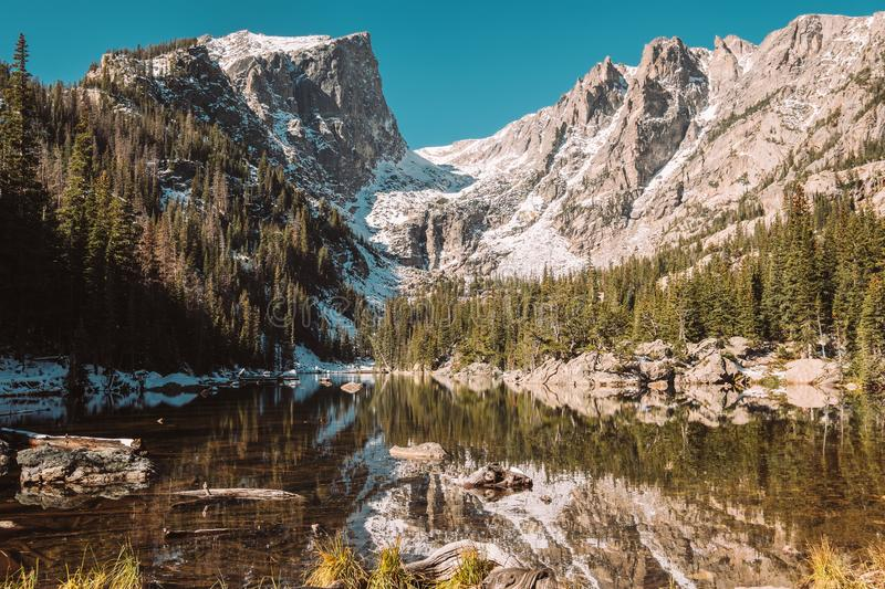 Dream Lake, Rocky Mountains, Colorado, USA. Dream Lake and reflection with mountains in snow around at autumn. Rocky Mountain National Park in Colorado, USA royalty free stock photos