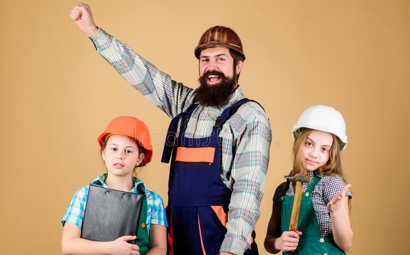 Dream team. Father builder and kids girls repair home. Teach daughter. Informal education. Fathers day. Sisters help stock photo