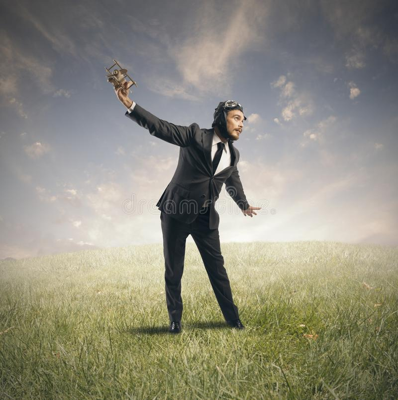 Dream to fly. Concept of a businessman who dreams to flying stock photography