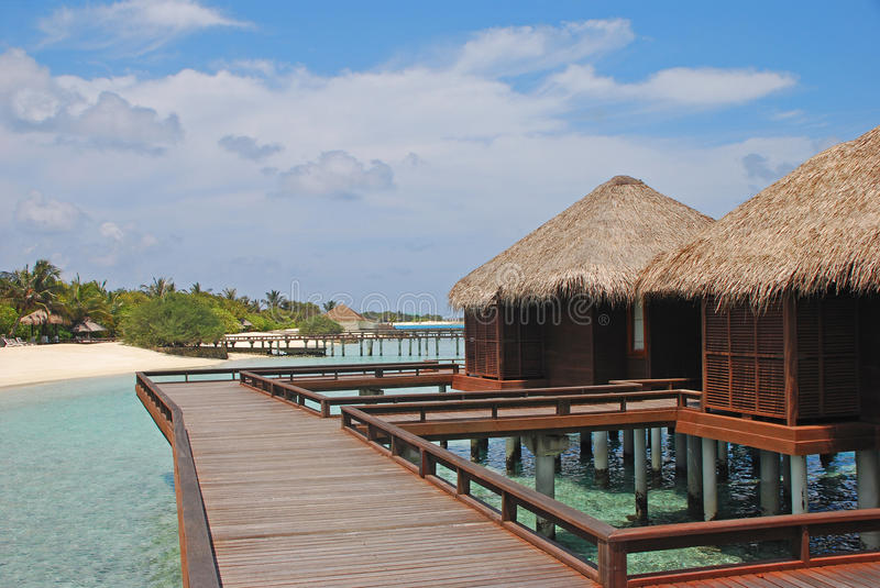 Dream Tropical Island Vacation in Traditional Wooden Overwater Bungalow royalty free stock photography