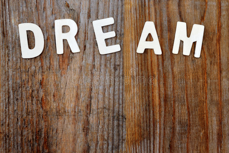 Dream word on wooden background royalty free stock image