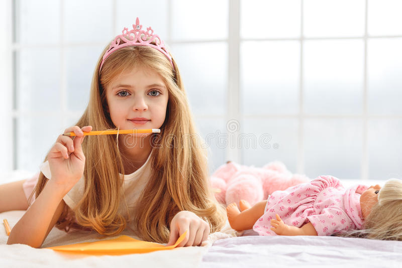 Dreamful girl writing romantic message royalty free stock photography
