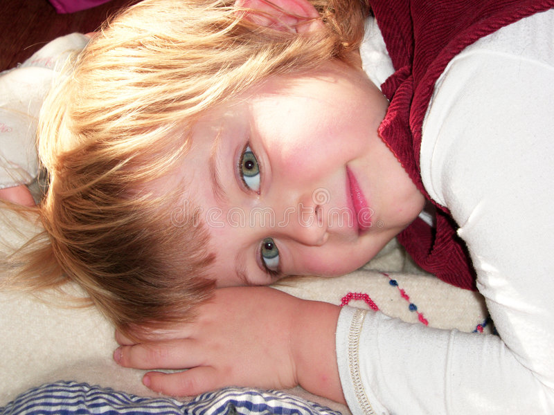 Dreaming. A young blond girl in dreamy mood stock image