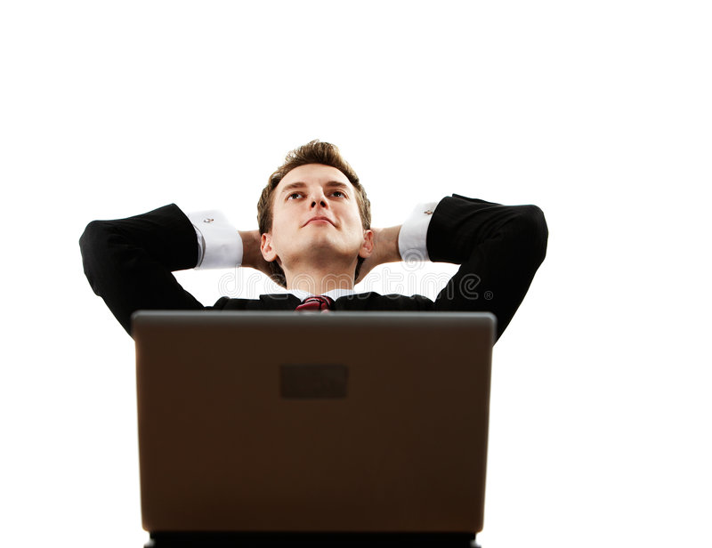 Dreaming. Young successful confident man with laptop dreaming royalty free stock photo