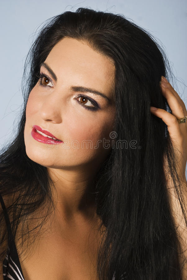 Dreaming beautiful young woman stock images