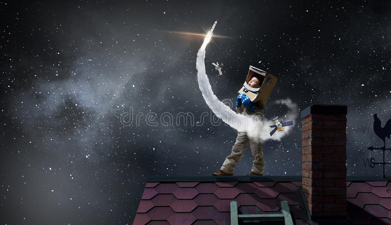 Dreaming of becoming a spaceman . Mixed media royalty free stock photo