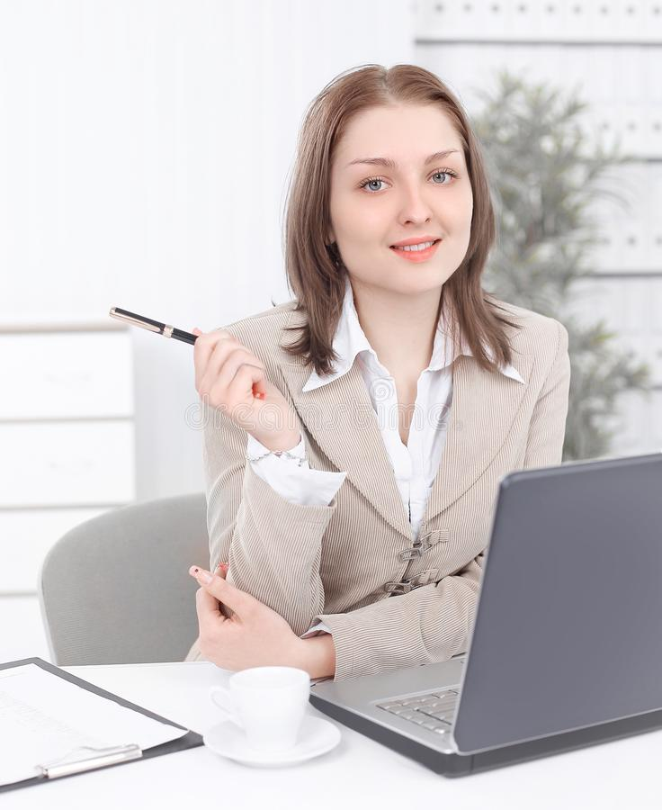 Dreaming business woman sitting at her Desk royalty free stock photography