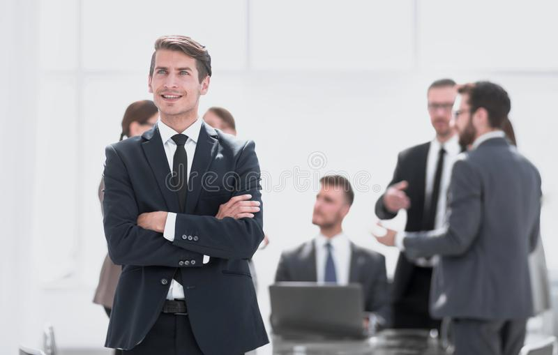Dreaming businessman on the background of the office. stock image