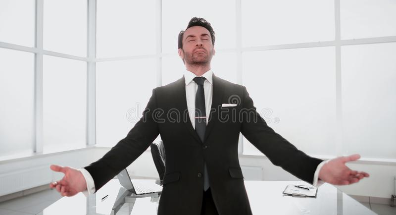 Dreaming businessman standing in his office royalty free stock photo