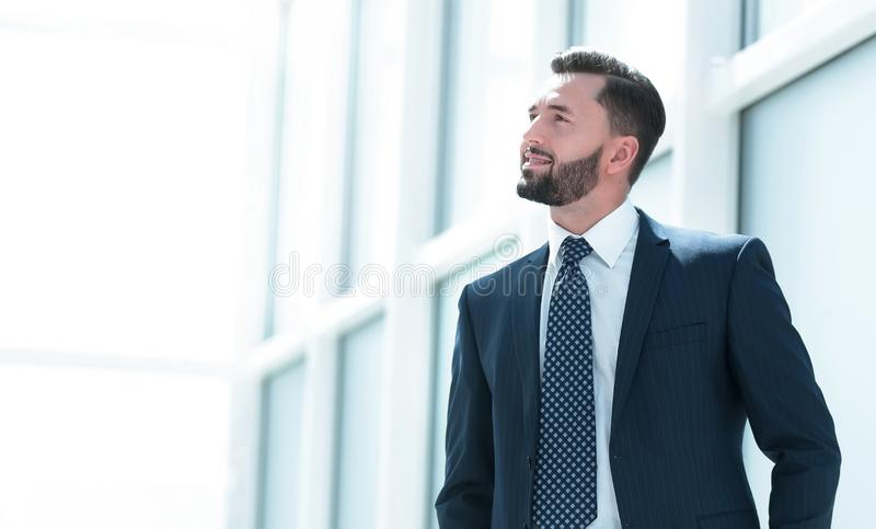 Dreaming of a businessman standing in new office stock image
