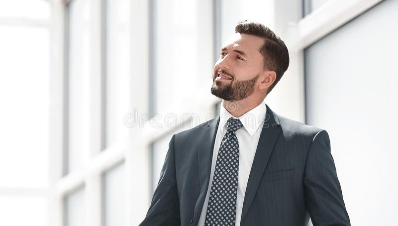 Dreaming of a businessman standing in new office royalty free stock photos