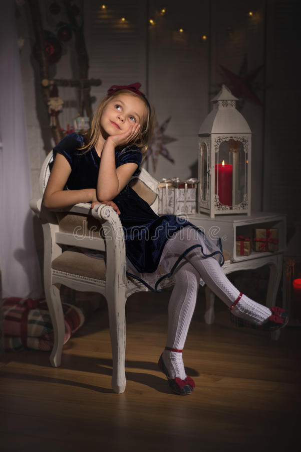 Dreaming about Christmas. A young girl ready for Christmas stock photography