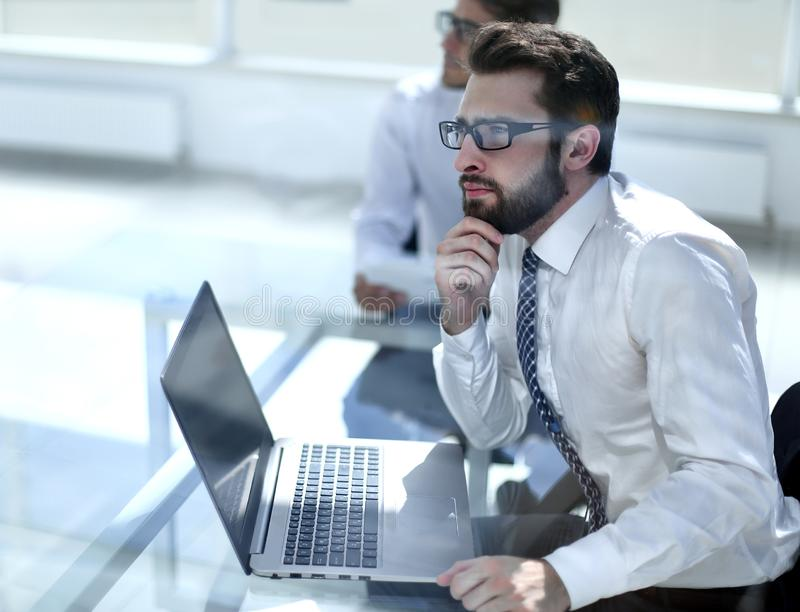 Dreaming employee sitting at the office Desk. Business concept stock photography