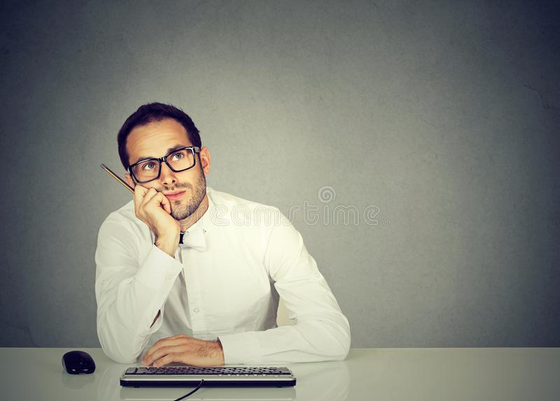 Dreaming employee sitting at table royalty free stock photos